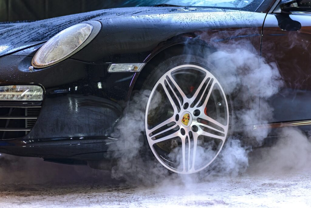 close up of porsche being washed