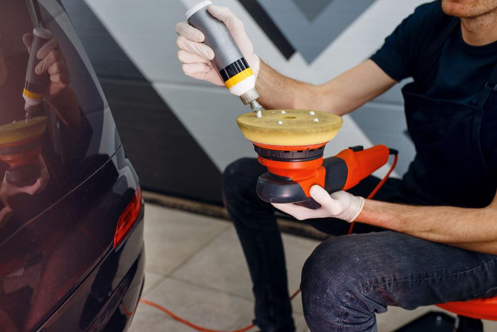 man preparing car for ceramic coating