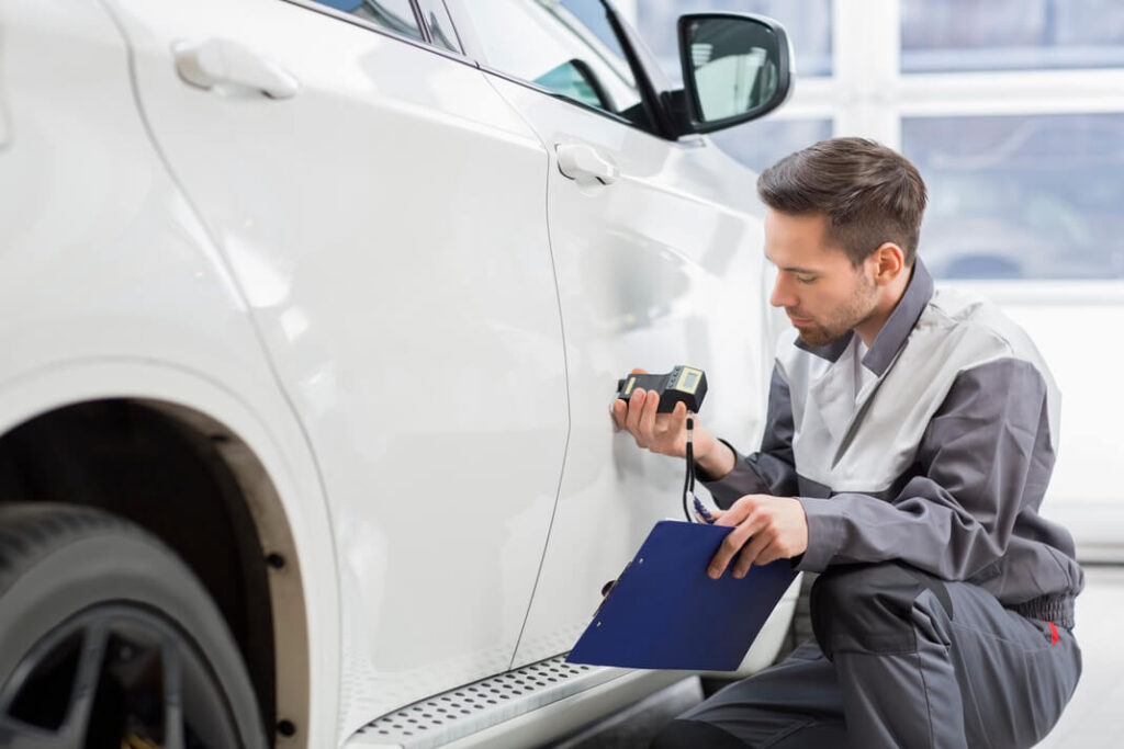 man looking at how to restore faded car paint