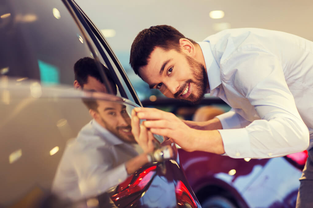 man happy after learning how to detail a car