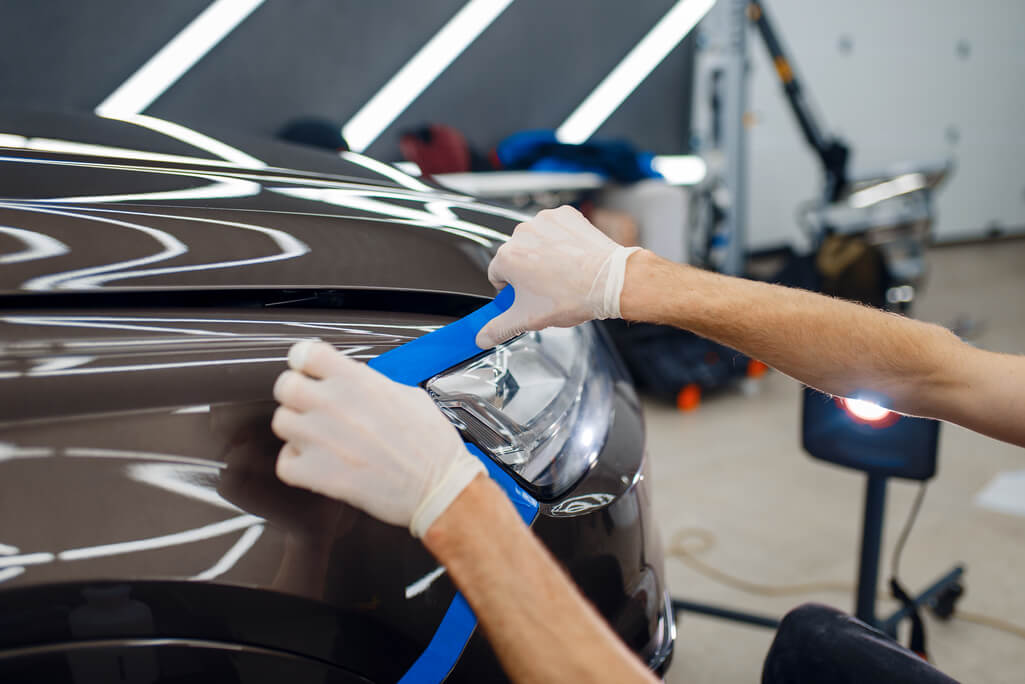 person preparing vehicle for car touch up paint
