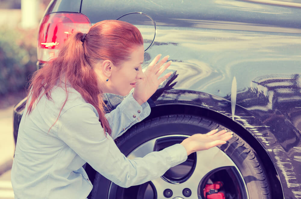 woman worried about how to remove scratches from car